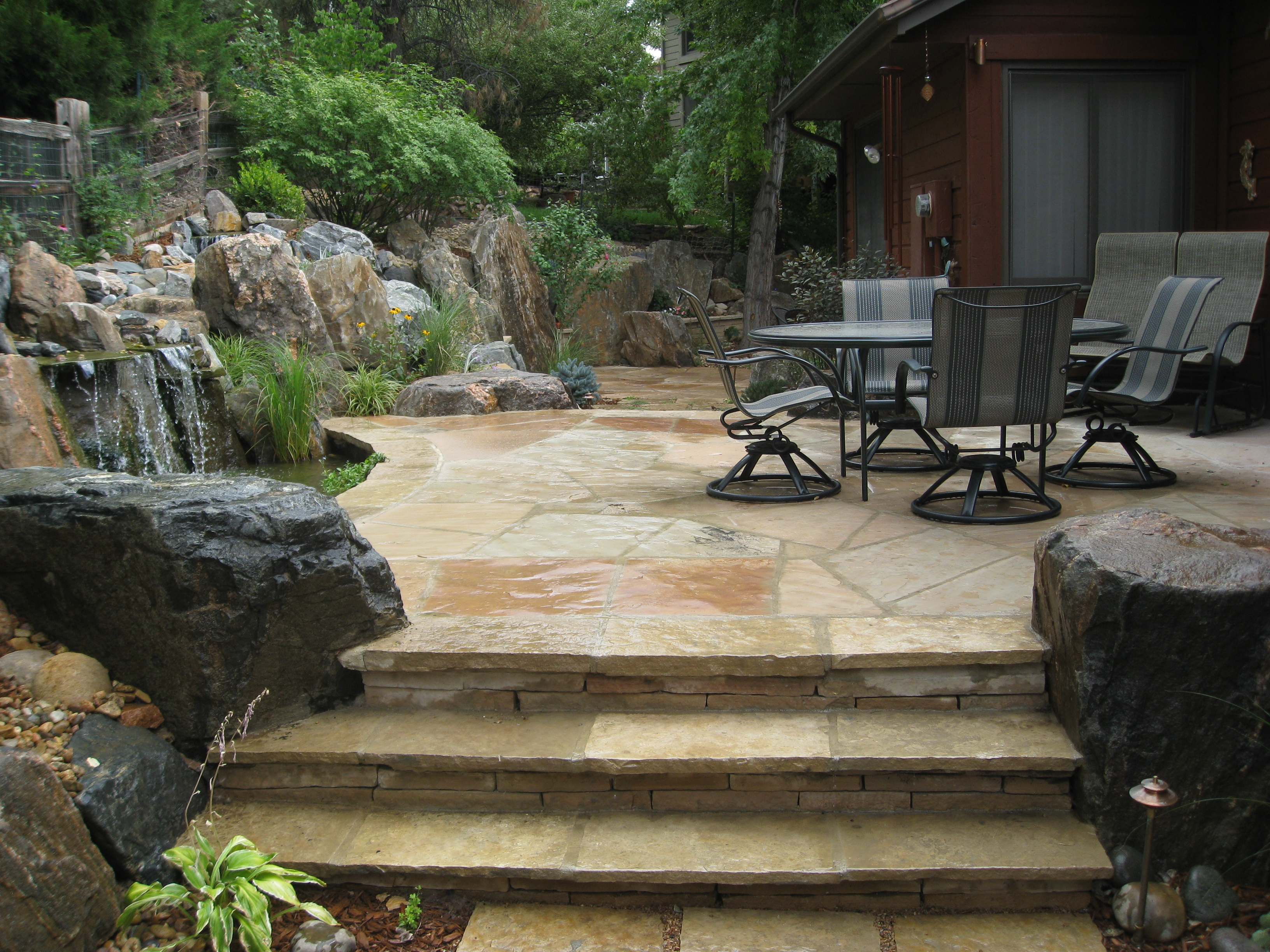 Flagstone Patio and Stairs with Boulders and Naturalistic Water